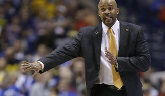 Tennessee head coach Cuonzo Martin directs his team during the second half of an NCAA Midwest Regional semifinal college basketball tournament game against the Michigan Friday, March 28, 2014, in Indianapolis. (AP Photo/Michael Conroy)