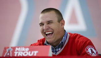 Los Angeles Angels' Mike Trout laughs during a media gathering held to announce his six-year contract extension with the Angels, at Angel Stadium on Saturday, March 29, 2014, in Anaheim, Calif. Trout and the Angels agreed Friday night to a $144.5 million, six-year contract, keeping baseball's brightest young star under club control through 2020. (AP Photo/Jae C. Hong)
