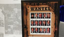 """In this Sept. 28, 2013 is a """"WANTED"""" poster displayed by the Missouri Club for Growth at a regional gathering of the Conservative Political Action Conference in St. Charles, Mo. The Club for Growth said it wanted to oust 15 Republican Missouri House members who had voted earlier in that month to sustain Democratic Gov. Jay Nixon's veto of a tax-cut bill. Those lawmakers face re-election face re-election this year. (AP Photo/David A. Lieb)"""