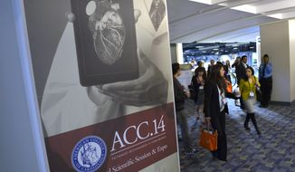 People attend the American College of Cardiology's conference in Washington, Saturday, March 29, 2014. A new class of experimental medicines can dramatically lower cholesterol, raising hopes of a fresh option for people who can't tolerate or don't get enough help from Lipitor and other statin drugs that have been used for this for decades. The first large studies of these drugs were presented Saturday at an American College of Cardiology conference in Washington, and more will follow on Sunday.  (AP Photo/Susan Walsh)