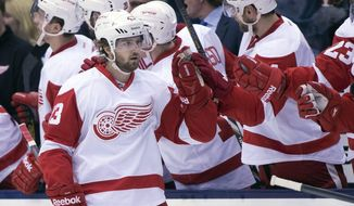 Detroit Red Wings centrer Darren Helm celebrates his first goal during second-period NHL hockey game action against the Toronto Maple Leafs in Toronto, Saturday, March 29, 2014. (AP Photo/The Canadian Press, Frank Gunn)