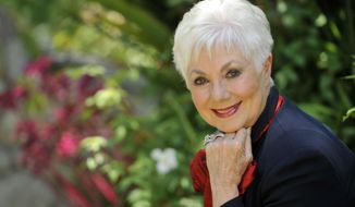 FILE - In this July 15, 2013 file photo, actress Shirley Jones poses for a portrait at her home in Los Angeles.  Jones wants to mark her 80th birthday with a high-flying adventure. The Oscar-winning actress and singer says she plans to go skydiving on Monday, March 31, 2014, her birthday, for the first time. (Photo by Chris Pizzello/Invision/AP, File)