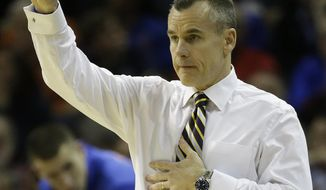 Florida head coach Billy Donovan, calls a lay against Dayton during the first half in a regional final game at the NCAA college basketball tournament, Saturday, March 29, 2014, in Memphis, Tenn. (AP Photo/Mark Humphrey)