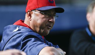 Cleveland Indians manager Terry Francona watches his team work out before a spring exhibition baseball game on Friday, March 28, 2014, in San Diego. (AP Photo/Lenny Ignelzi)