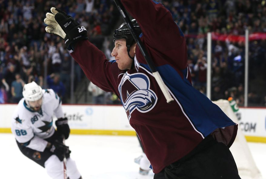 Colorado Avalanche left wing Cody McLeod, front, celebrates his short-handed goal as San Jose Sharks right wing Brent Burns reacts in the background in the first period of an NHL hockey game on Saturday, March 29, 2014, in Denver. (AP Photo/David Zalubowski)