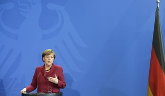 German Chancellor Angela Merkel speaks during a joint press conference with the Prime Minister of Canada Stephen Harper, as part of a meeting at the chancellery in Berlin, Germany, Thursday, March 27, 2014. (AP Photo/Michael Sohn)