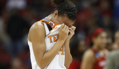 Tennessee guard Andraya Carter (14) leaves the court after losing 73-62 to Maryland in a regional semifinal game at the NCAA college basketball tournament on Sunday, March 30, 2014, in Louisville, Ky. (AP Photo/John Bazemore)