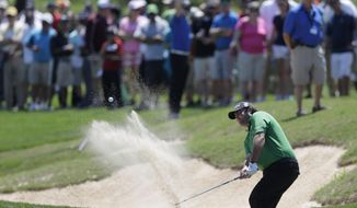 Steven Bowditch, of Australia, hits from a sand trap on the eighth hole during the final round of the Texas Open golf tournament on Sunday, March 30, 2014, in San Antonio. (AP Photo/Eric Gay)