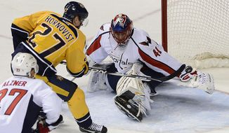 Nashville Predators forward Patric Hornqvist (27), of Sweden, scores against Washington Capitals goalie Jaroslav Halak (41), of Czech Republic, in the first period of an NHL hockey game on Sunday, March 30, 2014, in Nashville, Tenn.  (AP Photo/Mark Zaleski)
