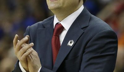Dayton head coach Archie Miller speaks to players against Florida during the first half in a regional final game at the NCAA college basketball tournament, Saturday, March 29, 2014, in Memphis, Tenn. (AP Photo/Mark Humphrey)