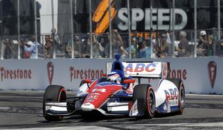 Takuma Sato, of Japan, leads during early laps of the IndyCar Grand Prix of St. Petersburg auto race, Sunday, March 30, 2014, in St. Petersburg, Fla. (AP Photo/Chris O'Meara)