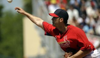 St. Louis Cardinals starting pitcher Adam Wainwright throws in the second inning of an exhibition spring training baseball game against the Washington Nationals, Wednesday, March 26, 2014, in Jupiter, Fla. (AP Photo/David Goldman)