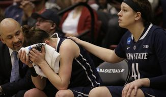 Penn State guard Maggie Lucas, center, is consoled by a assistant coach Fred Chmiel, left, and guard/forward Jenny DeGraaf (41) while sitting on the bench during the second half of a regional semifinal game against Stanford at the NCAA college basketball tournament in Stanford, Calif., Sunday, March 30, 2014. Stanford won 82-57. (AP Photo/Jeff Chiu)