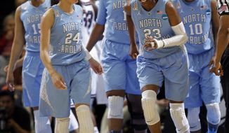 North Carolina guard Diamond DeShields (23) reacts after injuring herself during the first half of a regional semifinal against South Carolina at the NCAA college basketball tournament in Stanford, Calif., Sunday, March 30, 2014. (AP Photo/Marcio Jose Sanchez)