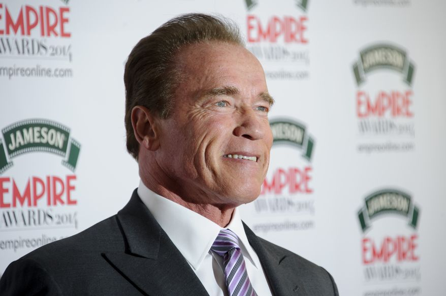 Austrian actor and former Governor of California Arnold Schwarzenegger arrives for the Empire Awards at a central London venue, London, Sunday, March 30, 2014. (Photo by Jonathan Short/Invision/AP)