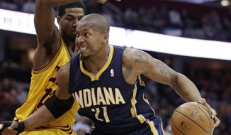 Indiana Pacers' David West, right, drives past Cleveland Cavaliers' Tristan Thompson, from Canada, during the second quarter of an NBA basketball game Sunday, March 30, 2014, in Cleveland. (AP Photo/Tony Dejak)
