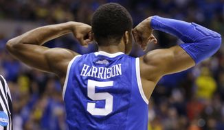 Kentucky's Andrew Harrison reacts during the first half of an NCAA Midwest Regional final college basketball tournament game against Michigan Sunday, March 30, 2014, in Indianapolis. (AP Photo/Michael Conroy)