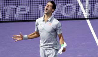 Novak Djokovic of Serbia, celebrates after defeating Rafael Nadal of Spain, 6-3, 6-3 during the men's final match at the Sony Open Tennis tournament on Sunday, March 30, 2014, in Key Biscayne, Fla. (AP Photo/Wilfredo Lee)