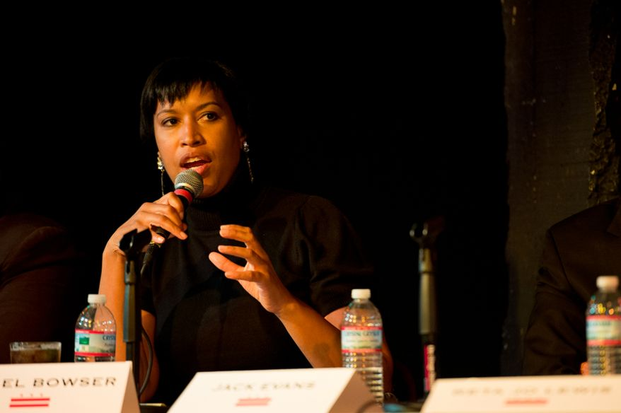 Councilmember Muriel Bowser (D-Ward 4) speaks at a mayoral debate hosted by the Washington City Paper at the Black Cat on 14th Street in Northwest, Washington, D.C., Sunday, March 16, 2014. Incumbent Mayor Vincent Gray was invited but did not attend. (Andrew Harnik/The Washington Times)