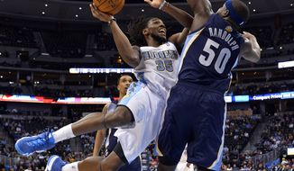 Denver Nuggets forward Kenneth Faried (35) goes up for a shot against Memphis Grizzlies forward Zach Randolph (50) during the third quarter of an NBA basketball game on Monday, March 31, 2014, in Denver. (AP Photo/Jack Dempsey)