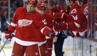 Detroit Red Wings' David Legwand (17) celebrates his team's first-period goal with a teammate during an NHL hockey game against the Tampa Bay Lightning, Sunday, March 30, 2014, in Detroit. (AP Photo/Duane Burleson)