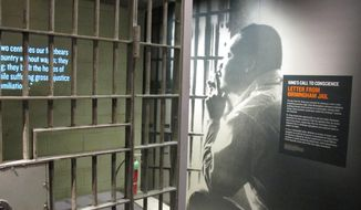 This March 19, 2014 photo shows a recreation of a jail cell in Montgomery, Ala. where Martin Luther King was held in 1963 at the newly-renovated National Civil Rights Museum in Memphis, Tenn. The museum, which first opened in 1991, is now ready to show off new, emotionally-moving exhibits and flashy, informative interactive displays. The museum says it attracts 200,000 people every year, but the renovations are impressive enough that they could lead to a spike in visitor turnout. (AP Photo/Adrian Sainz)