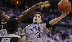 FILE - In this March 8, 2014 file photo, Creighton's Doug McDermott (3) goes for a layup against Providence's LaDontae Henton (23) and Providence's Kadeem Batts (10) in an NCAA college basketball game in Omaha, Neb. McDermott  was selected to The Associated Press All-America team, released Monday, March 31, 2014. (AP Photo/Nati Harnik)