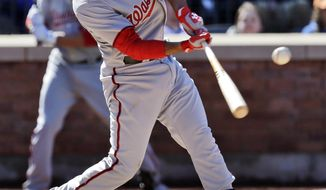 Washington Nationals' Anthony Rendon hits an RBI double during the seventh inning of a baseball game against the New York Mets on opening day at Citi Field in New York, Monday, March 31, 2014. (AP Photo/Seth Wenig)