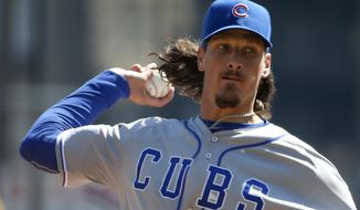 Chicago Cubs starting pitcher Jeff Samardzija throws in the second inning against the Pittsburgh Pirates during their opening day baseball game on Monday, March 31, 2014, in Pittsburgh. (AP Photo/Gene Puskar)