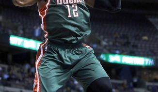 Milwaukee Bucks forward Jeff Adrien (12) dunks the ball against the Detroit Pistons during the first half of an NBA basketball game Monday, March 31, 2014, in Auburn Hills, Mich. (AP Photo/Duane Burleson)