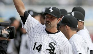 Chicago White Sox first baseman Paul Konerko acknowledges the crowd as he is introduced during an opening day baseball game against the Minnesota Twins Monday, March 31, 2014, in Chicago. (AP Photo/Charles Rex Arbogast)