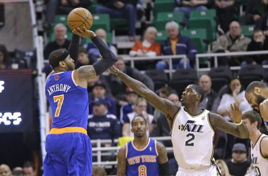 New York Knicks' Carmelo Anthony (7) shoots as Utah Jazz's Marvin Williams (2) defends in the first quarter during an NBA basketball game Monday, March 31, 2014, in Salt Lake City. (AP Photo/Rick Bowmer)