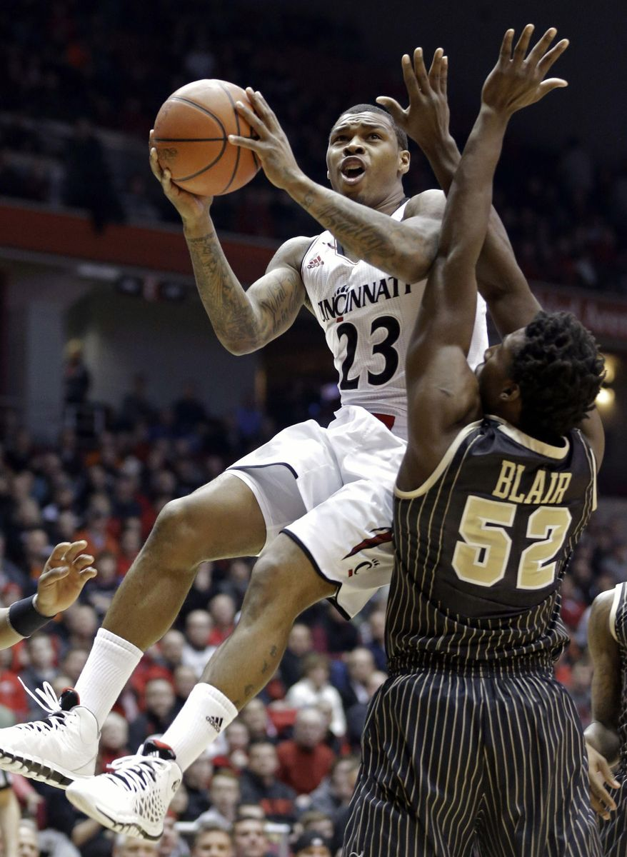 FILE - In this Jan. 23, 2014 file photo, Cincinnati guard Sean Kilpatrick (23) drives against Central Florida forward Staphon Blair (52) in the first half of an NCAA college basketball game in Cincinnati. Kilpatrick was selected to The Associated Press All-America team, released Monday, March 31, 2014. (AP Photo/Al Behrman)