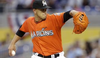 Miami Marlins starting pitcher Jose Fernandez throws during the first inning of an opening day baseball game against the Colorado Rockies, Monday, March 31, 2014, in Miami. (AP Photo/Lynne Sladky)
