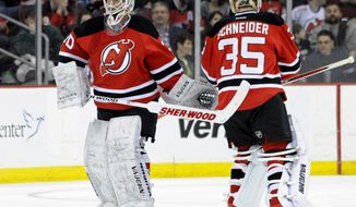 New Jersey Devils goaltender Martin Brodeur, left, leaves the game as he is replaced by Cory Schneider during the second period of an NHL hockey game against the Florida Panthers Monday, March 31, 2014, in Newark, N.J. (AP Photo/Bill Kostroun)