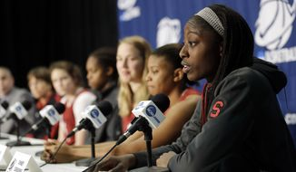 Stanford forward Chiney Ogwumike, right, joins the rest of the team's starters during a news conference at the NCAA college basketball tournament on Monday, March 31, 2014, in Stanford, Calif. Stanford plays North Carolina in a regional final on Tuesday. (AP Photo/Marcio Jose Sanchez)