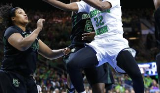 Notre Dame guard Jewell Loyd (32) drives on Baylor's Khadijiah Cave, left, and Baylor guard Imani Wright (20) in the first half of their NCAA women's college basketball tournament regional final game at the Purcell Pavilion in South Bend, Ind., Monday, March 31, 2014. (AP Photo/Paul Sancya)