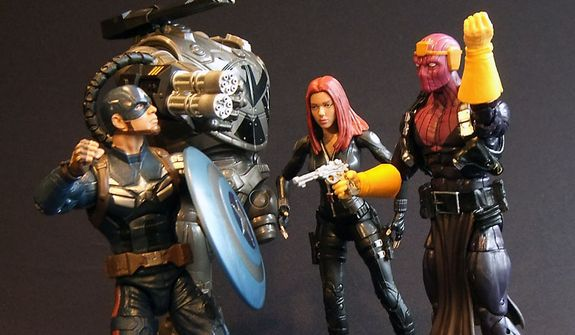 Hasbro's Marvel Infinite Series Legends Captain America, Black Widow and a partially built Mandroid Build-a-Figure attack Baron Zemo. (Photograph by Joseph Szadkowski / The Washington Times)