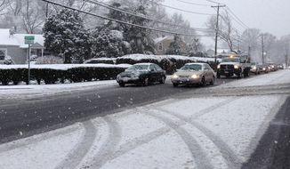 A spring snowfall covers a neighborhood, Monday, March 31, 2014 in Farmingdale, NY.  Around an inch of snow covered vehicles and stuck to roads during the Monday morning rush-hour in Farmingdale, on Long Island.   A dusting of snow also appeared north of the city, in Westchester County. (AP Photo/Frank Eltman)
