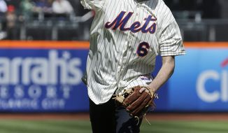 New York City Mayor Bill de Blasio throws out the ceremonial first pitch before a baseball game between the New York Mets and the Washington Nationals on opening day at Citi Field in New York, Monday, March 31, 2014.  (AP Photo/Seth Wenig)