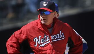 Washington Nationals manager Matt Williams stands on the field during the second inning of the baseball game against the New York Mets on Opening Day at Citi Field in New York, Monday, March 31, 2014.  (AP Photo/Seth Wenig)
