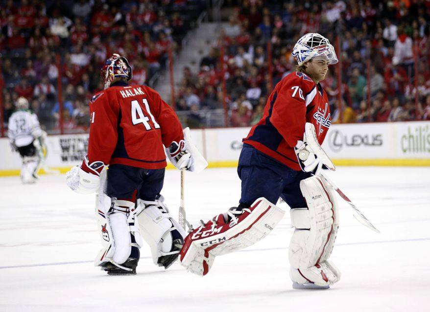 Washington Capitals goalie Jaroslav Halak (41), from the Czech Republic, is replaced by goalie Braden Holtby (70) in the second period of an NHL hockey game against the Dallas Stars, Tuesday, April 1, 2014, in Washington. (AP Photo/Alex Brandon)