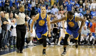 Golden State Warriors guard Stephen Curry (30) and forward Draymond Green (23) run downcourt after Curry hit the game-winning shot in overtime during and NBA basketball game against the Dallas Mavericks, Tuesday, April 1, 2014, in Dallas. Golden State won 122-120. (AP Photo/Matt Strasen)