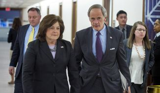 United States Secret Service director Julia Pierson and Senate Homeland Security Committee Chairman Tom Carper, D-Del., leave a committee hearing on recent Secret Service agents behavior, on Capitol Hill in Washington, Tuesday, April 1, 2014. (AP Photo/Cliff Owen) ** FILE **