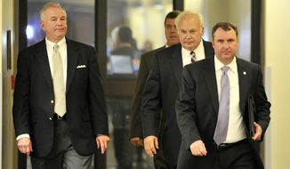 Former Alabama state Rep. Greg Wren, R-Montgomery, left, arrives at Montgomery County District Court Tuesday, April 1, 2014, in Montgomery, Ala. Wren resigned from the Legislature on Tuesday before pleading guilty to a misdemeanor ethics violation. (AP Photo/AL.com, Julie Bennett)  MAGS OUT