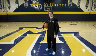 FILE - In this Dec. 3, 2012, file photo, Marquette assistant women's NCAA college basketball coach Tyler Summitt poses for a picture in Milwaukee. Louisiana Tech has hired the 23-year-old Summitt, son of former Tennessee coach Pat Summitt, to take over the Lady Techsters. Summitt, who'll turn 24 in September, has not yet been a head coach in his fledgling career. He's spent the past two seasons as an assistant coach at Marquette. (AP Photo/Morry Gash, File)