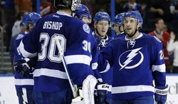 Tampa Bay Lightning right wing Ryan Callahan, right, congratulates goalie Ben Bishop after the team defeated the Montreal Canadiens 3-1 during an NHL hockey game Tuesday, April 1, 2014, in Tampa, Fla. (AP Photo/Chris O'Meara)