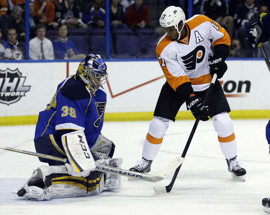 Philadelphia Flyers' Wayne Simmonds, right, watches as St. Louis Blues goalie Ryan Miller deflects a puck during the first period of an NHL hockey game Tuesday, April 1, 2014, in St. Louis. (AP Photo/Jeff Roberson)