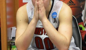 Louisville's Sara Hammond pauses in the locker room following a regional final against Maryland in the NCAA women's college basketball tournament Tuesday, April 1, 2014, in Louisville, Ky. Maryland defeated Louisville 76-73. (AP Photo/Timothy D. Easley)