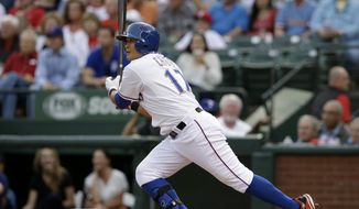 Texas Rangers' Shin-Soo Choo follows through on a single to center off Philadelphia Phillies' A.J. Burnett in the first inning of a baseball game, Tuesday, April 1, 2014, in Arlington, Texas. (AP Photo/Tony Gutierrez)
